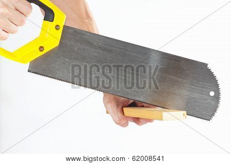 Hand sawing a wooden block with a hacksaw