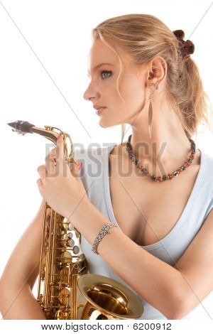 nice sexy blonde girl with saxophone standing with dreaming look