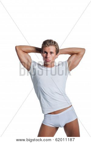 Beefy guy advertises underwear, isolated on white
