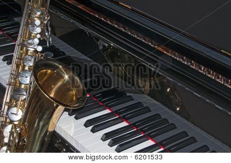 Saxaphone Against A Black Grand Piano