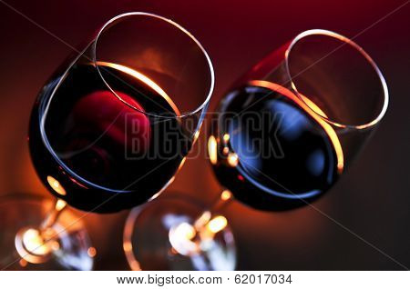 Two wineglasses with red wine at candlelight