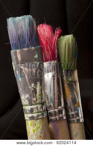 Three Paintbrushes In Different Colors