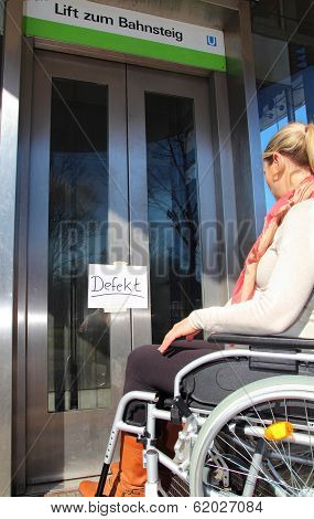 Wheelchair User On A Defect Elevator