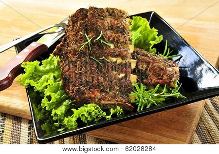 Plate of spare ribs and greens for dinner