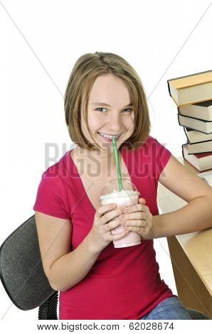 Teenage girl holding a cup with milkshake