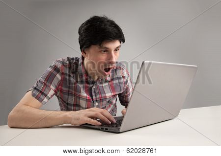 Shocking Man Reading Message On Laptop Computer
