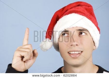 Young Christmas Man Pointing Up