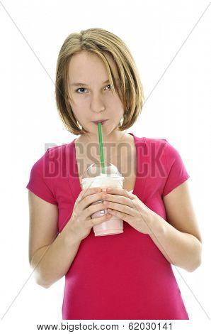 Teenage drinking strawberry milkshake isolated on white background