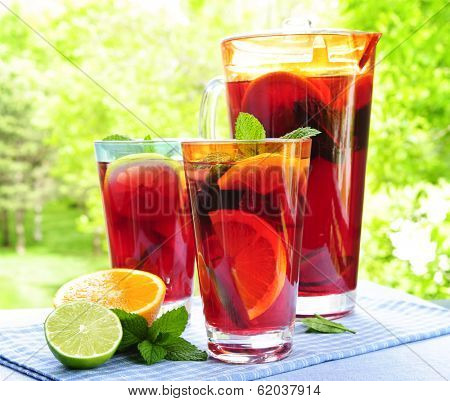 Refreshing fruit punch beverage in pitcher and glasses