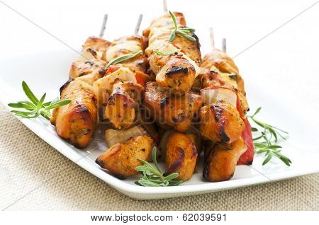 Pile of barbecued chicken kebab appetizers on a plate
