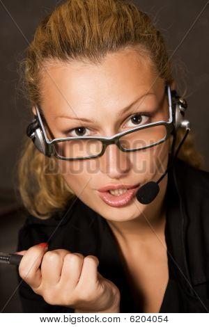 Business woman talking over headphones