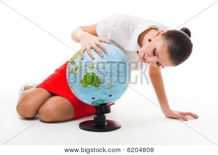 Business Woman Searching County On The Globe