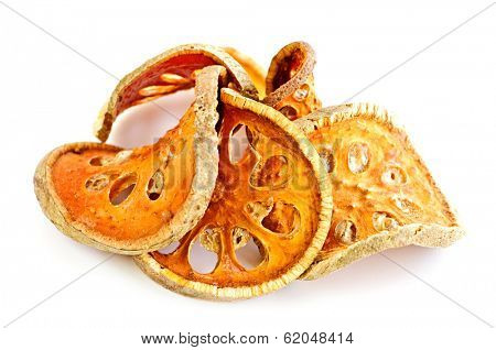 Slices of dried bael fruit on white background