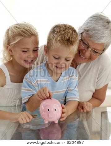 Close-up Of Grandmother And Children Saving Money