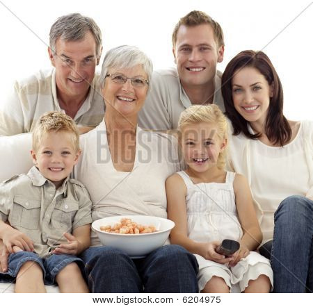 Portrait Of Family Watching Television And Eating Chips