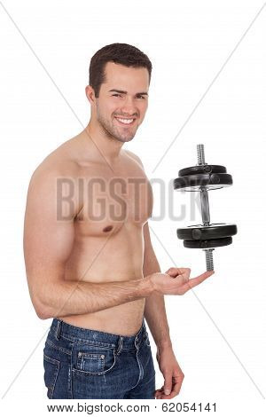 Young Bodybuilder Male Holding Dumpbell