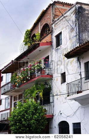 Balconies with flower boxes on old building in Puerto Vallarta, Jalisco, Mexico