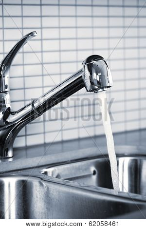 Stainless steel kitchen faucet and sink with running water