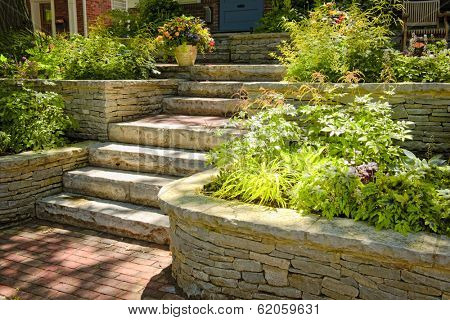 Natural stone landscaping in home garden with stairs