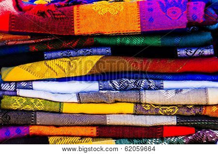 Colorful blankets at the market.