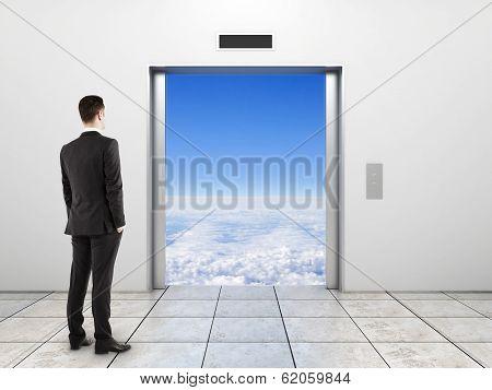 Businessman Looking To Elevator