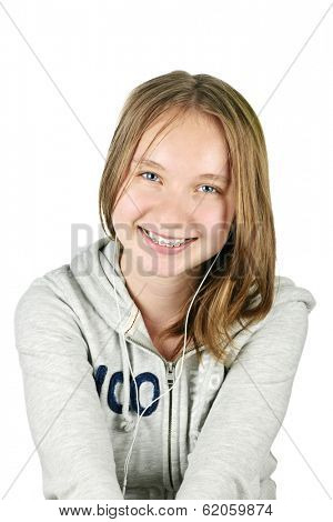 Isolated portrait of beautiful teenage girl listening to earphones