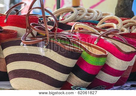 Straw handbags in Mexican market.