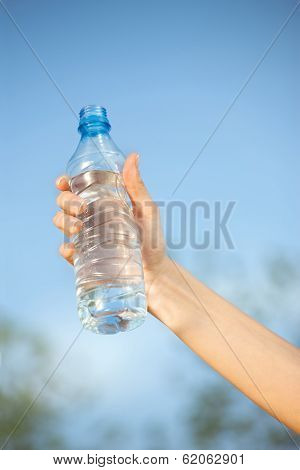 Hand Holding Plasic Bottle Of Water