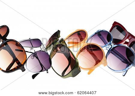 Different styles of tinted sunglasses on white background