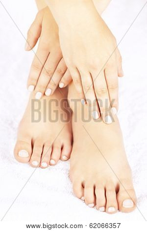 Soft female feet and hands with pedicure and manicure