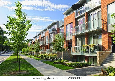 Modern town houses of brick and glass on urban street