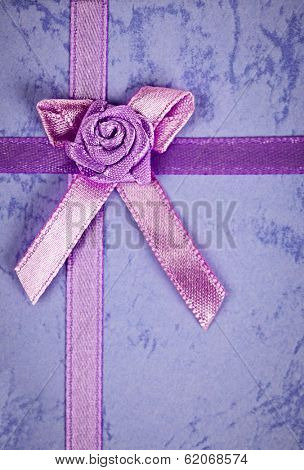 Pink gift ribbon and bow on present