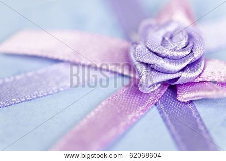 Closeup of pink gift ribbon and bow on present