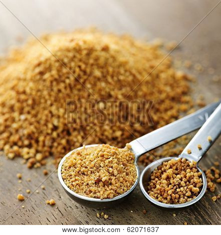 Organic coconut palm sugar in measuring spoons