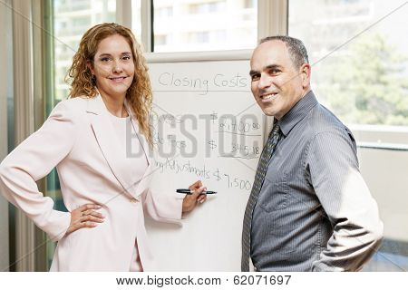 Real estate agent using flip chart with closing cost data
