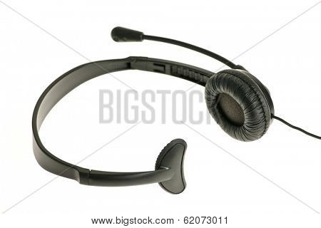 Black headset with one earpiece and microphone isolated on white background