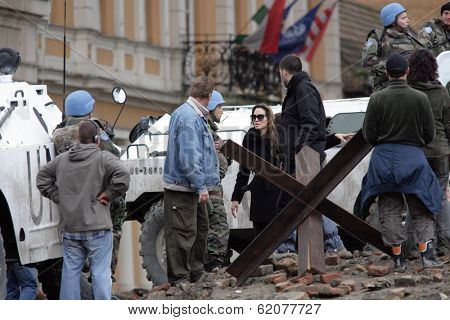 ESZTERGOM, HUNGARY - NOVEMBER 10: Angelina Jolie gives instructions to actors dressed as peace keepers on the set of In The Land Of Blood And Honey filming in Esztergom, Hungary, on Wednesday, November 10, 2010.