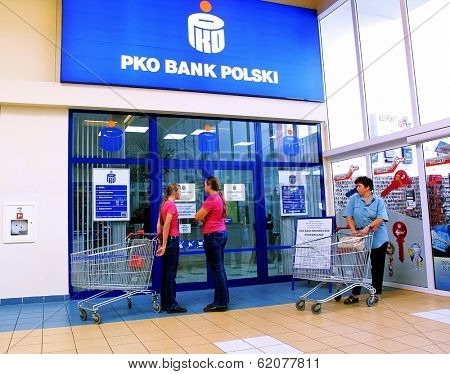 KRAKOW, POLAND, 25 OCTOBER 2003 -- A customer withdraws money from a Bank PKO BP automated teller cash machine. Bank PKO is one of Poland's leading financial institutions.