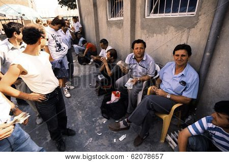 TIRANA, ALBANIA, 09 MARCH 1996 - Money changers in Tirana, Albania, wait for customers in an open air market. Albania descended into anarchy following the collapse of the banking system.