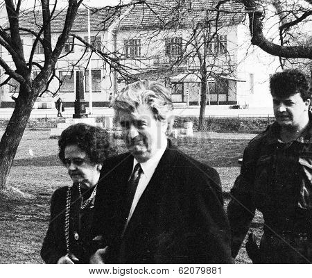 PALE, BOSNIA - MAR 14: Bosnian Serb leader Radovan Karadzic, his wife Ljiljana Zelen and bodyguard attend church services in Pale, Bosnia,  on Sunday, March 14, 1993.