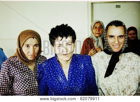 MOSTAR, BOSNIA - AUG 17: Women patients at a psychiatric institute take cover from machinegun fire during fierce fighting between Bosnian Muslim and Bosnian Croatian forces in Mostar, Bosnia, on Tuesday, August 17, 1993.