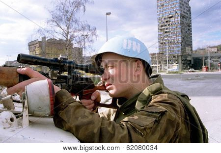 SARAJEVO, BOSNIA - APRIL 25: A Ukrainian soldier with the United Nations Protection Force in Bosnia watches for Serb snipers ringing the besieged Bosnian capital.SARAJEVO, BOSNIA - MAR 18:  Italian troops, in Bosnia as part of a NATO force, patrol an apar