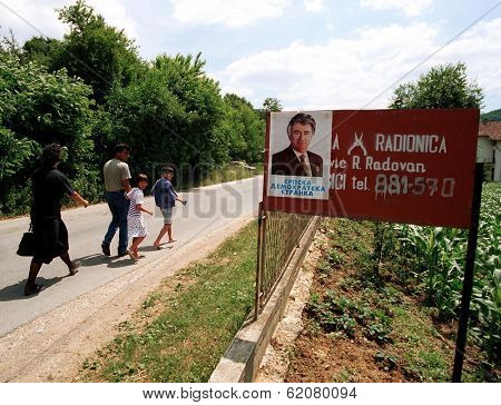SREBRENICA, BOSNIA - JULY 9: Posters proclaiming support for former Bosnian Serb leader Radovan Karadzic adorn a sign in front of Bosnian Serb house on July 9, 1998 in the town of Srebrenica, Bosnia.
