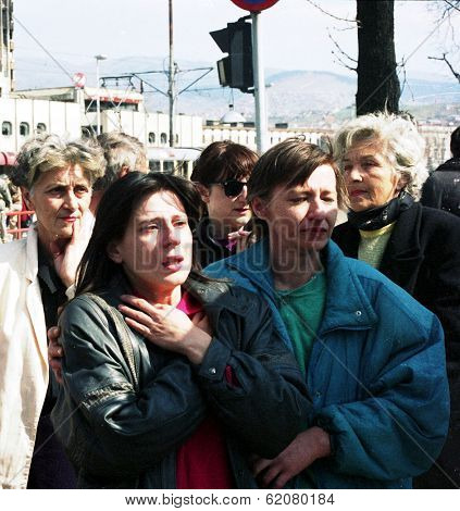 SARAJEVO, BOSNIA - APR 24: Women wait to be reunited with loved ones in front of a French UNPROFOR checkpoint in Sarajevo, Bosnia, on Sunday, April 24, 1994.