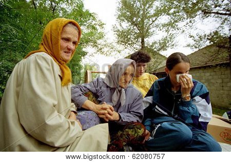 VRANIC, KOSOVO, 09 OCTOBER 1998 --- Sabria Shehu, 65, left, along with her neighbors return, to their destroyed homes in the village of Vranic after being evicted by Serb army forces.