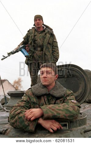 INGUSHETIA-CHECHEN BORDER - NOVEMBER 10: Russian army troops pass through a border checkpoint on their way to front-line positions in Chechnya on November 10, 1999 in Ingushetia - Chechen Border