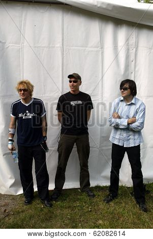 BUDAPEST, HUNGARY - AUGUST 10: Die Aerzte (Die Arzte) perform at the annual Sziget music festival in Budapest, Hungary, on Tuesday, August 10, 2004. From left, drummer Bela B., guitarist Farin Urlaub and bassist Rod Gonzales