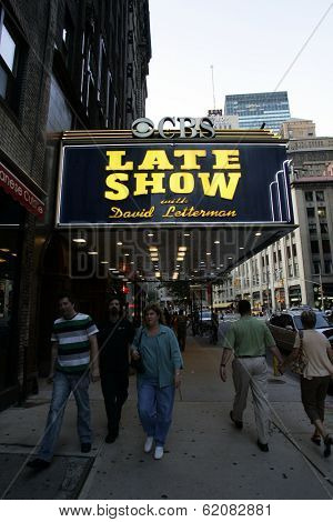 NEW YORK - JULY 14: Pedestrians walk beneath the marquee of  CBS TV's  David Letterman show at the Ed Sullivan theater in New York City, New York, on Tuesday, July 14, 2009.