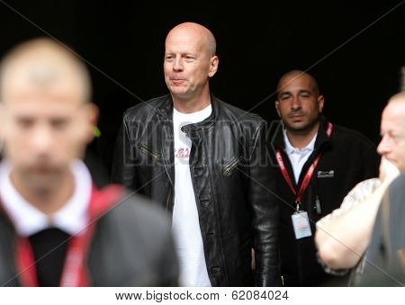 BUDAPEST - MAY 7: Actor Bruce Willis arrives for the first day of shooting on the set of Die Hard 5: A Good Day To Die Hard in Budapest, Hungary, on Monday, May 7, 2012.