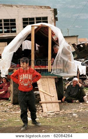KUKES, ALBANIA, 17 APRIL 1999 --- Kosovar Albanian refugees take refuge at a makeshift camp just across the border in northern Albania. Tens of thousands of ethnic Albanians have fled Kosovo.